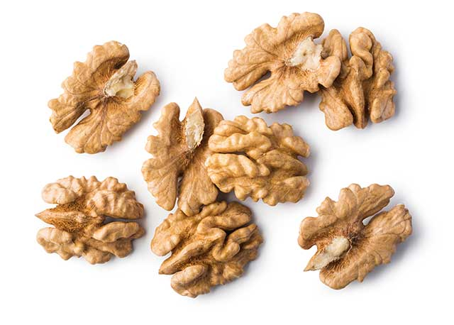 Several Walnuts In a Pile.