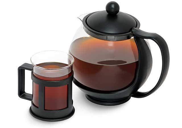 Teapot and Cup Both Containing Chaga Mushroom Tea.