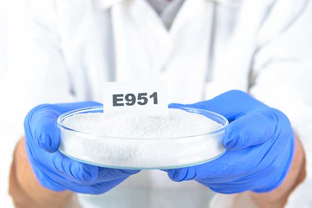 Scientist Holding Food Additive Number E951 (Aspartame).