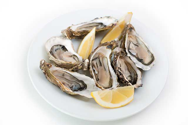 Fresh Oysters With Slices of Lemon.