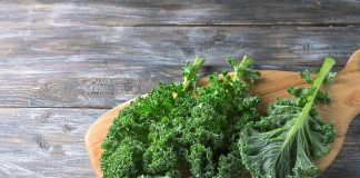 Kale Leaves On a Wooden Board.