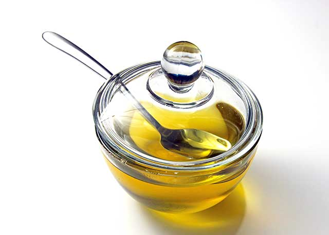 Liquid Ghee In a Glass Container.