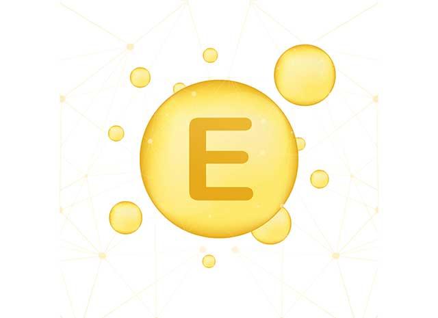 Vitamin E Letter In Gold Bubble.