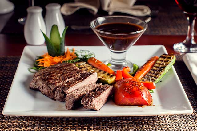 Beef Steak With Grilled Vegetables On a White Squared Plate.