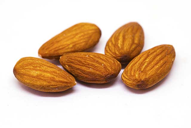 Close-up Photo of Five Almond Nuts.