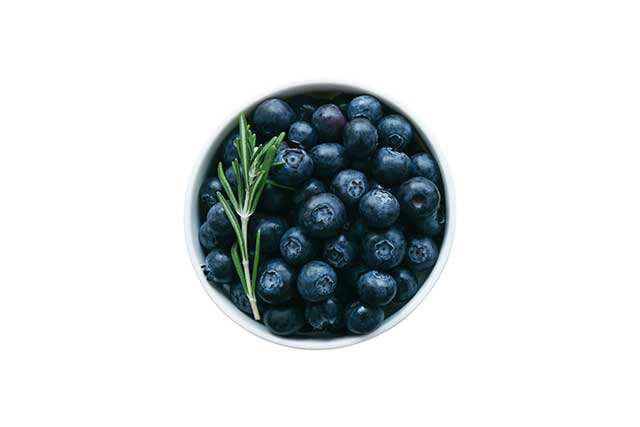 Fresh Wild Blueberries In a White Bowl.