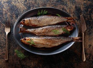 Three Grilled Whole Herring Fillets On a Plate.
