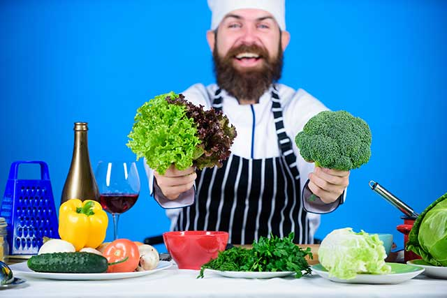 Chef With Table of Vegan Foods.