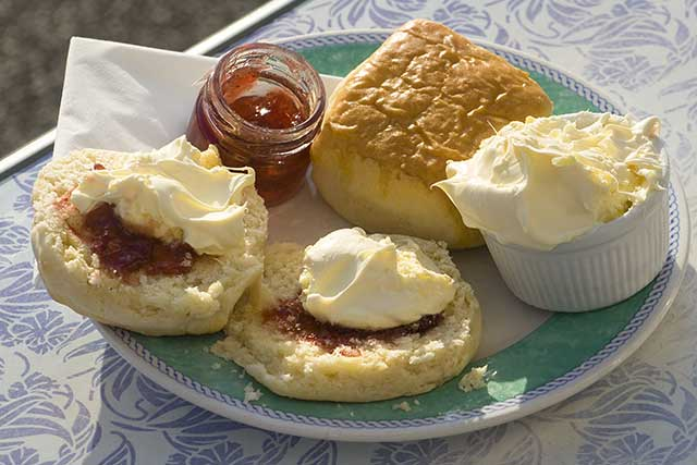 Clotted Cream, Scones, and Strawberry Jam - Traditional British Snack.
