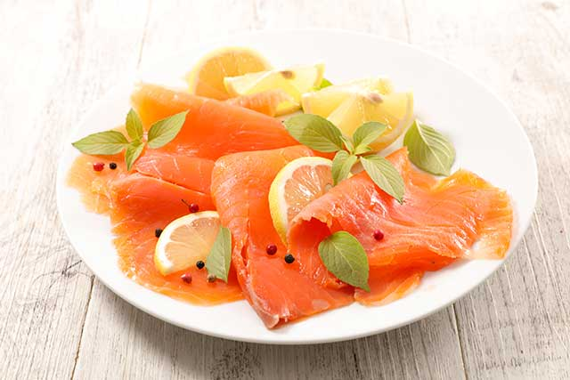 Plate of Smoked Salmon With Citrus Fruit.