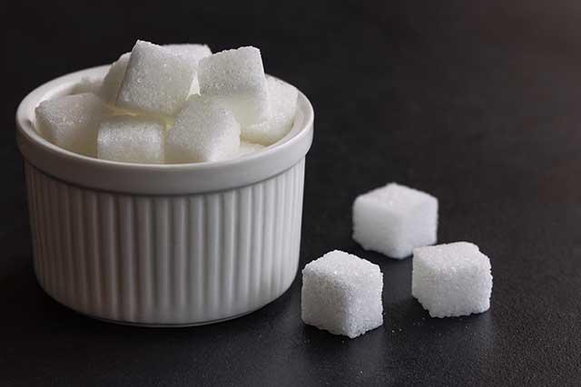 Sugar Cubes In a White Bowl.