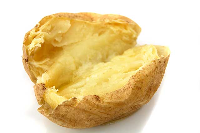 Baked Potato Filled With Yellow Butter.