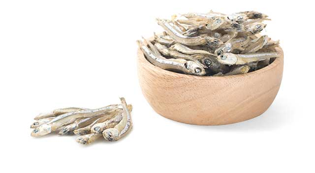 Dried Anchovies In a Wooden Bowl.