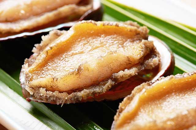 Fresh Abalone Shellfish On a Green Leaf.