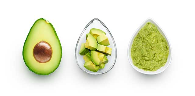Half an Avocado, Chopped Pieces, and Guacamole In Three Dishes.