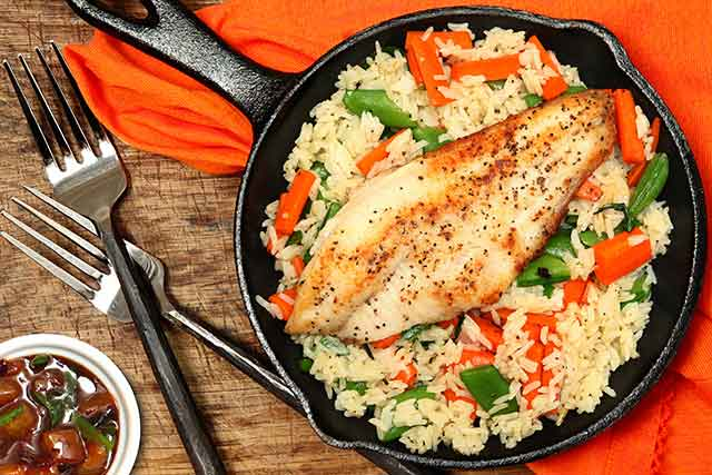 Cooked Catfish In Cast Iron Skillet Pan.