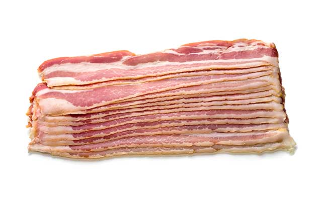 Uncooked Slices of Bacon In a Big Pile.