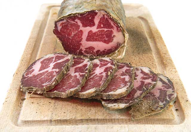 Capocollo Cured Italian Meat Sausage and Slices.
