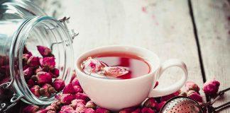 Cup of Rose Tea Next To Rosebuds.