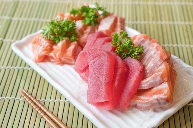 Mixed Sashimi Platter Featuring Tuna and Salmon.