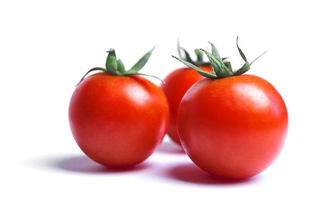 Close-up Photo of Three Fresh Red Tomatoes.