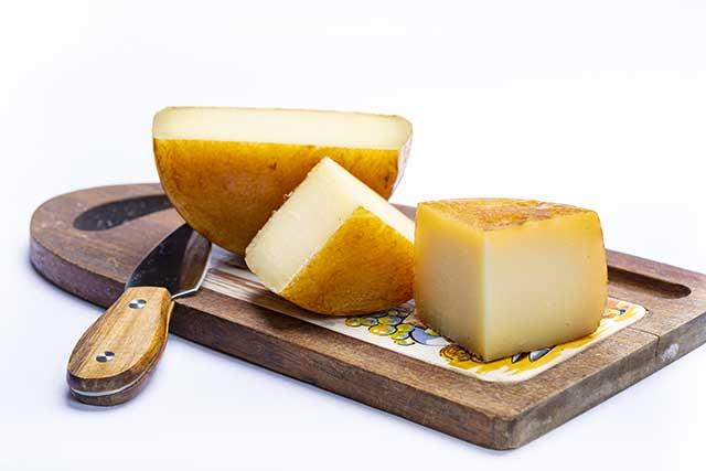 Hard Italian Cheeses On a Wooden Board.