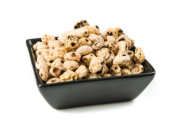 Pile of Tiger Nuts In Large Black Bowl.
