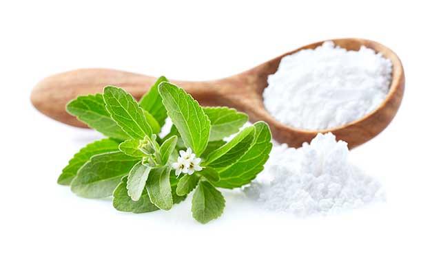 Stevia Leaves and White Powdered Sweetener.