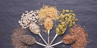 Different Types of Seeds On Metal Spoons.