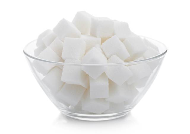 A Glass Bowl Full of Sugar Cubes.