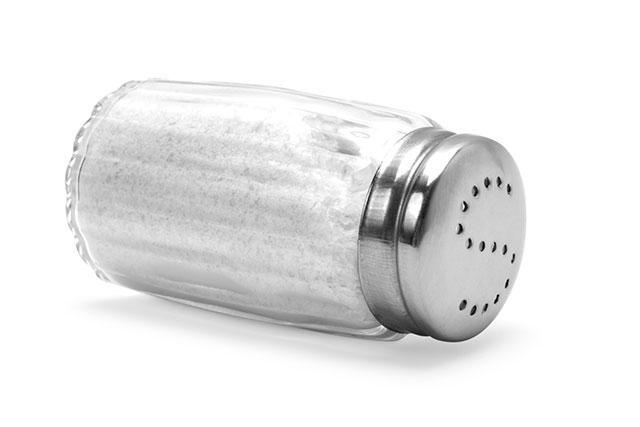 A Glass Salt Shaker Full of Salt.