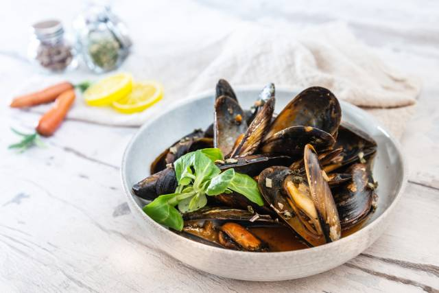 Dish of Mussels With White Wine Sauce.