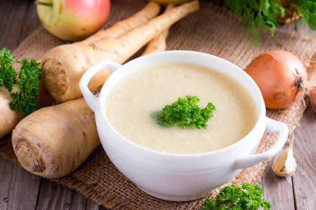 Parsnip Cream Soup In a White Bowl.