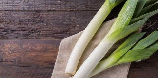 Leeks On a Wooden Table.