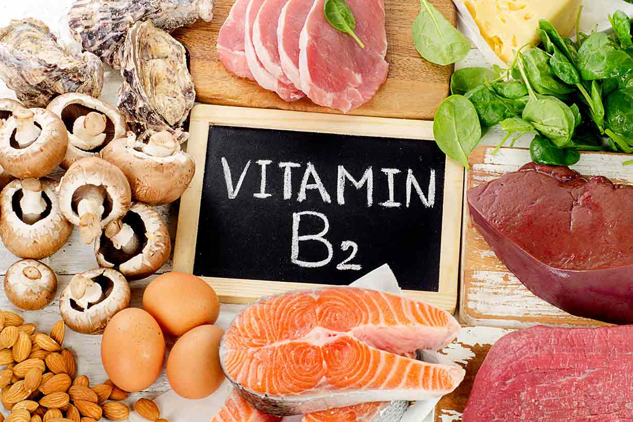 Foods High In Riboflavin (With a Vitamin B2 Sign in the Middle).