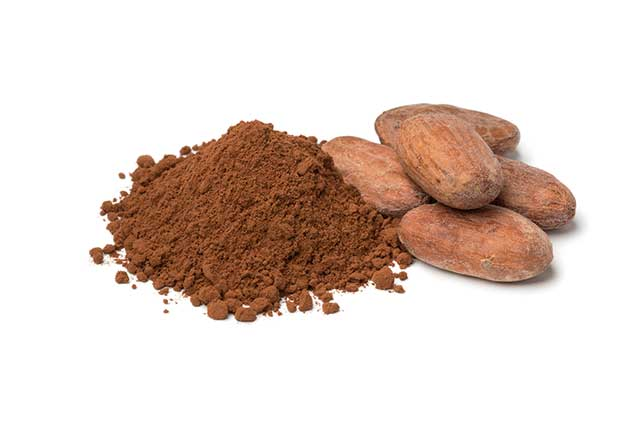 Pile of Cocoa Powder Next To Cocoa Beans.