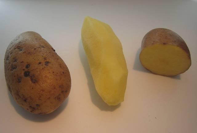 Fresh Peeled and Unpeeled Almond Potatoes.