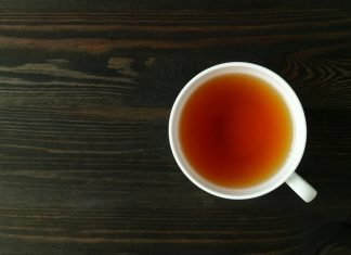 Cup of Barley Tea On a Wooden Surface.