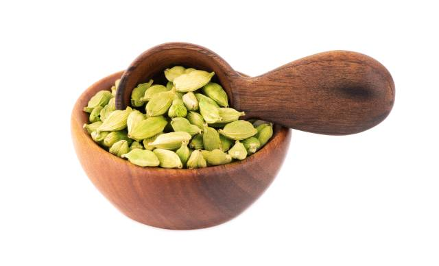 Cardamom Seeds In a Wooden Bowl.