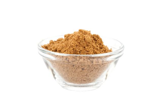 Garam Masala Powder In Clear Glass Bowl.