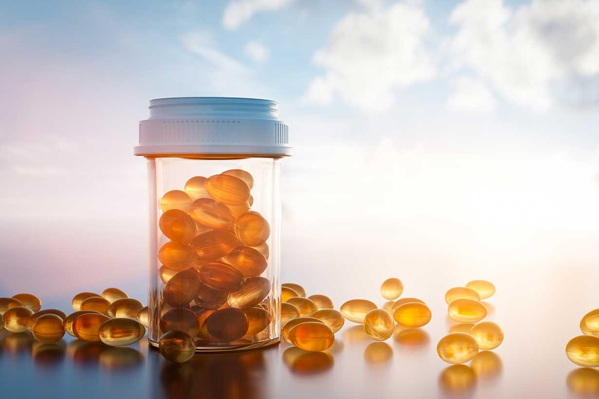 Vitamin D Capsules In a Glass Jar.