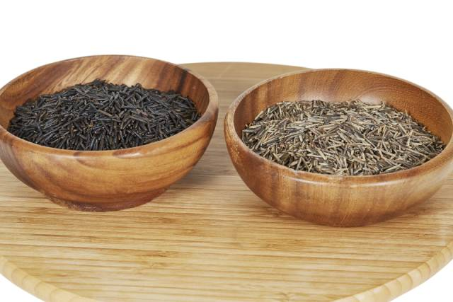 Different Strains of Wild Rice In Two Wooden Bowls.