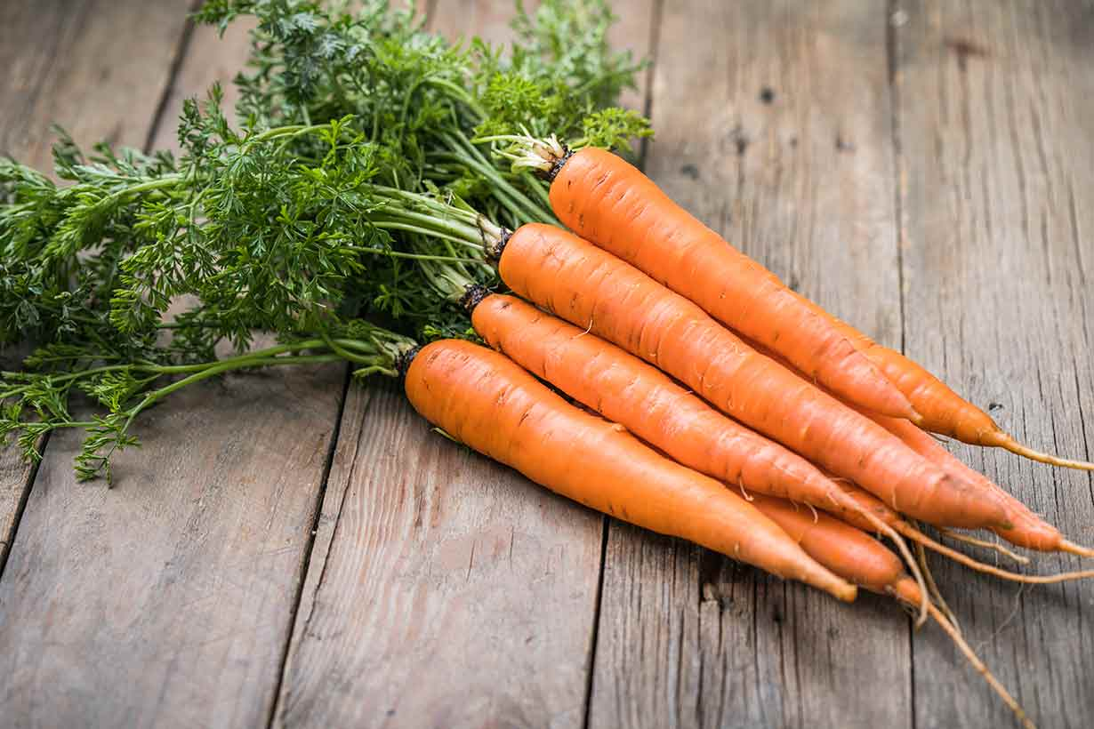 A Bunch of Carrots On a Wooden Surface.