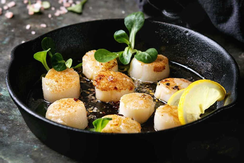 Browned Scallops In a Cast Iron Pan.