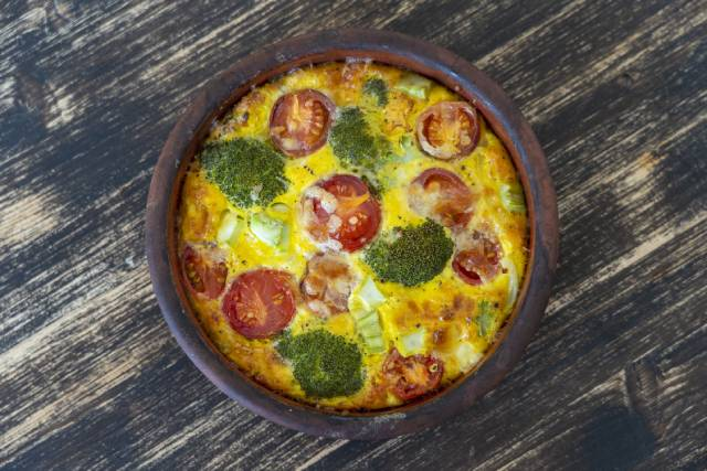 A vegetable frittata in a ceramic bowl.