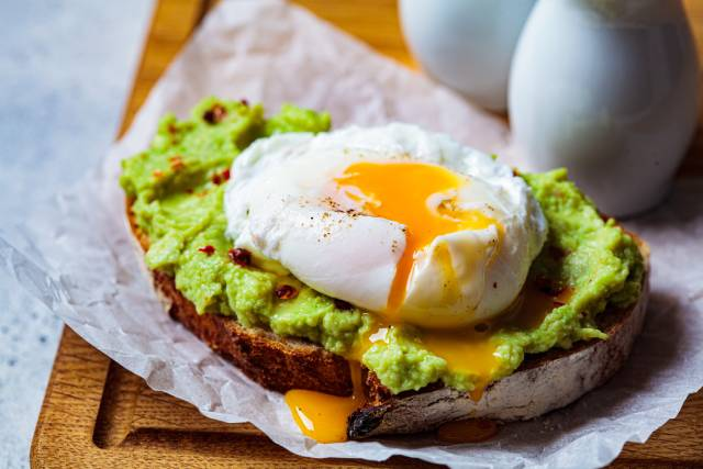 Poached egg on top of avocado toast.