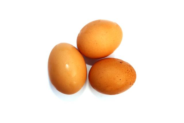 Three whole chicken eggs next to each other.